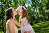 Love - mother kissing her child — Stock Photo