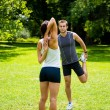 Warm up - couple exercising before jogging — Stock Photo #22568037