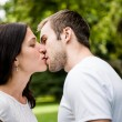 Stock Photo: Young kissing couple in love