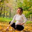 Autumn mood - pregnant woman outdoor — Stock Photo #22569601