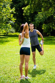 Warm up - couple exercising before jogging — Stok fotoğraf