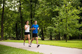 Jogging together - young couple running — Stock Photo