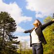 Woman enjoys life outdoors — Stock Photo #23005720