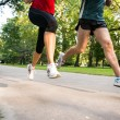 Jogging couple - detail of legs — Stock Photo