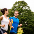 Running together - young couple jogging — Stock Photo #23489451