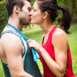 Young sport kissing couple - Stockfoto
