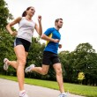 Jogging together - sport young couple — Stock Photo