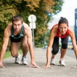 Rivalry - young couple competing in running — Stockfoto #23489795