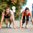 Rivalry - young couple competing in running — Stock Photo #23489795