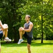 Warm up - couple exercising before jogging — Stock Photo #23489993