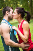 Young sport kissing couple — Stock Photo