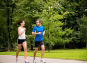 Jogging together - young couple training — Stock Photo