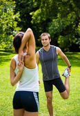 Warm up - couple exercising before jogging — Stockfoto