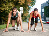 Rivalry - young couple competing in running — Stock Photo
