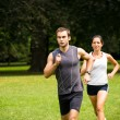 Stock Photo: Running together - young couple jogging