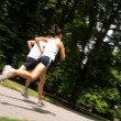 Stock Photo: Young couple jogging - motion blurr