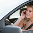 Portrait of young smiling person driving car — Stock Photo