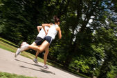 Young couple jogging - motion blurr — Stock Photo