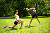 Warm up - couple exercising before jogging — Стоковое фото
