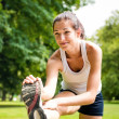 Stretching exercise - sport woman outdoor — Stock Photo