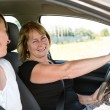 Mature woman with daughter driving car — Stock Photo
