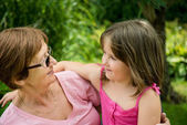 Together - grandmother with granddaughter — Stock Photo