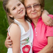 Love - grandmother with granddaughter portrait — Stock Photo