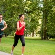 Training together - young couple jogging — Stock Photo