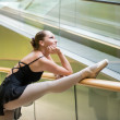 Ballet dancer at escalator — Stock Photo