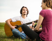 Playing guitar - romantic couple — Stock Photo