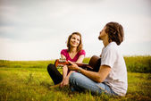 Playing guitar - romantic couple — Stock Photo