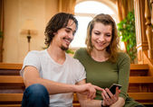 Couple with smartphone — Stock Photo
