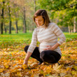 Autumn mood - pregnant woman outdoor — Stock Photo