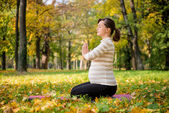 Meditation - pregnant woman outdoor — Stock Photo