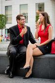 Young couple having icecream — Stock Photo