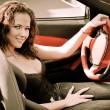 Young beautiful woman in sport car — Stock Photo