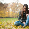 Young woman in depression outdoor — Stock Photo #30945275