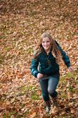 Autumn pleasure - young woman runing — Stock Photo