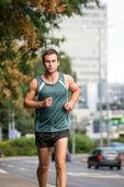 Training - man running in street — Stock Photo