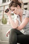 Bad message - unhappy woman with mobile phone — Stock Photo