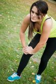 Knee injury - woman in pain after sport — Stock Photo