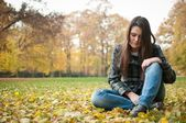 Young woman in depression outdoor — Stock Photo