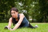 Woman stretching muscles before jogging — Stock Photo