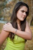Shoulder pain - young woman with sport injury — Stock Photo