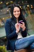 Mobility - woman with smartphone — Stock Photo