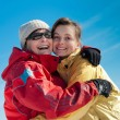 Happy mother and daughter in winter — Stock Photo