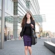 Business woman walking in hurry — Stock Photo