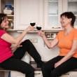 Happy life - mother and daughter drinking wine — Stock Photo