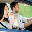 Stock Photo: Eating in car
