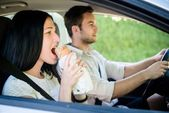 Eating in car — Stock Photo